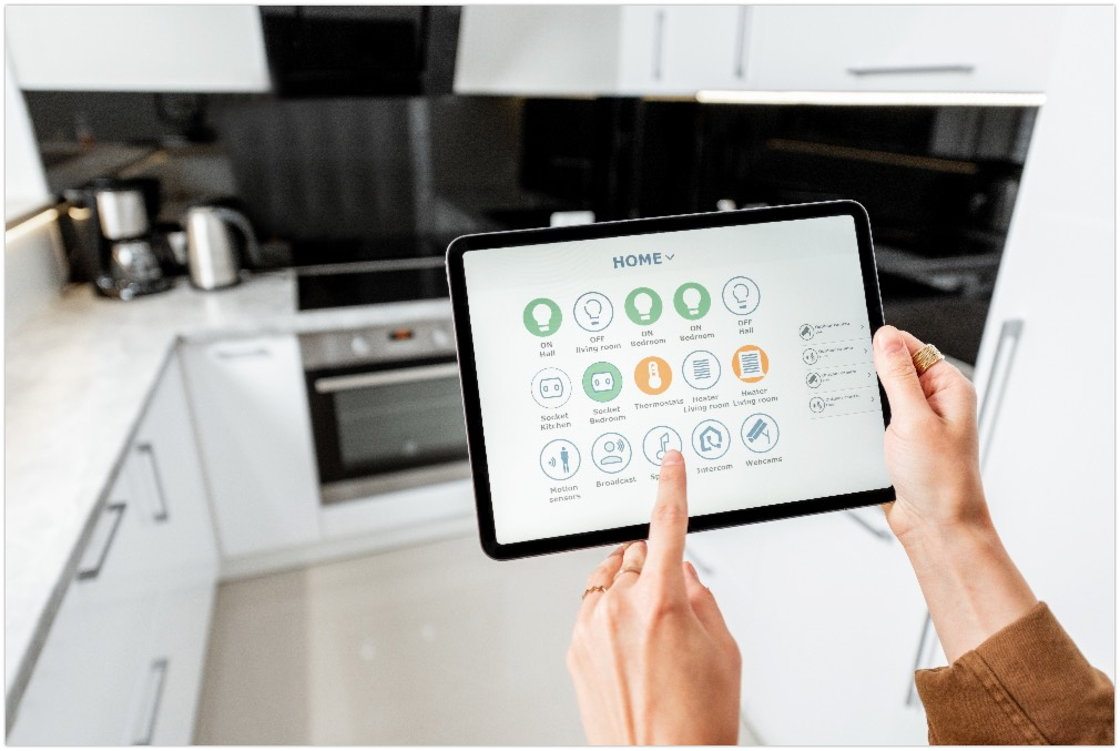 Woman controlling kitchen appliances with a digital tablet, close-up on mobile device with launched smart home application